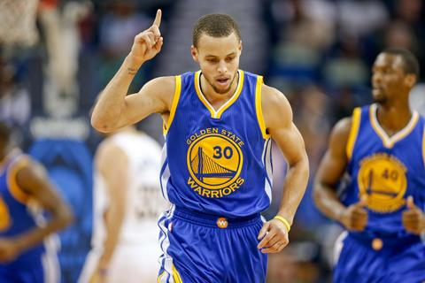 Dec 14, 2014; New Orleans, LA, USA; Golden State Warriors guard Stephen Curry (30) reacts after scoring against the New Orleans Pelicans during the first half of a game at the Smoothie King Center. Mandatory Credit: Derick E. Hingle-USA TODAY Sports